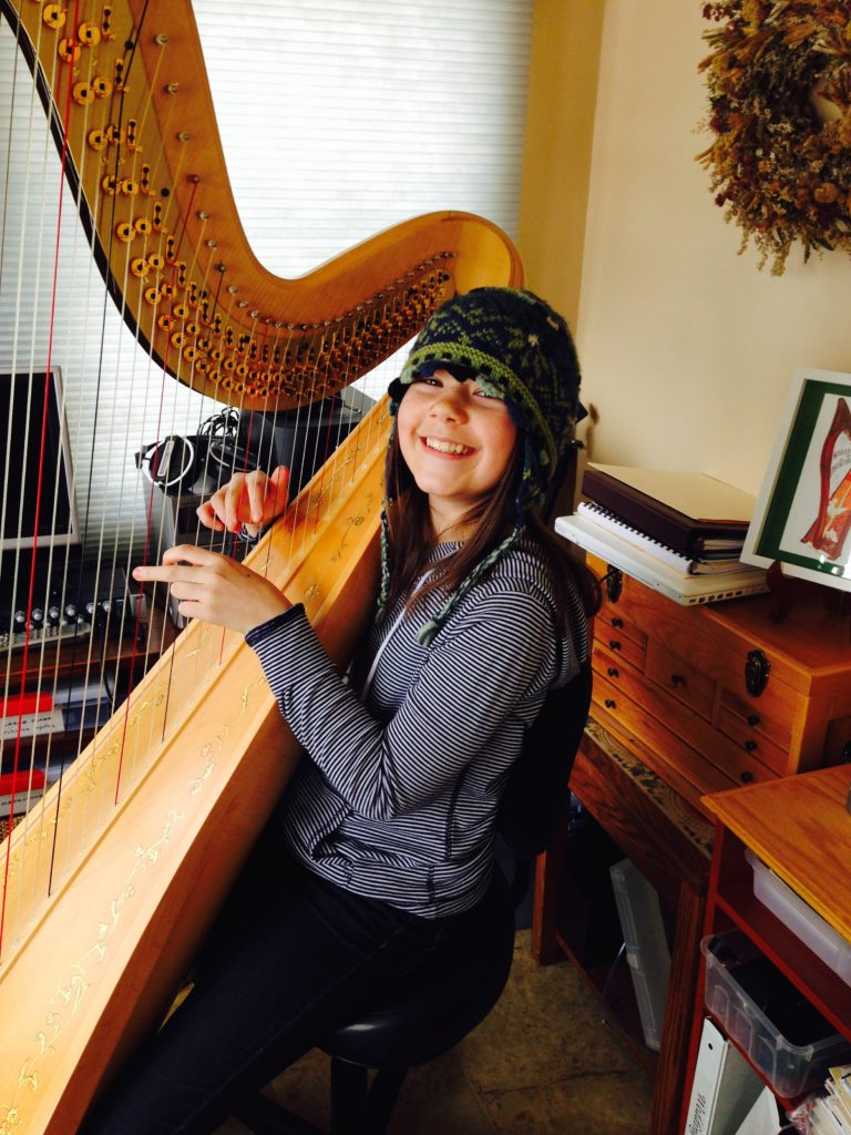 Hannah McCardle playing the pedal harp