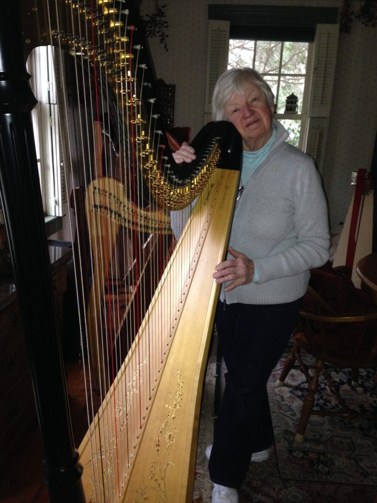 Joann Ryan with her pedal harp.