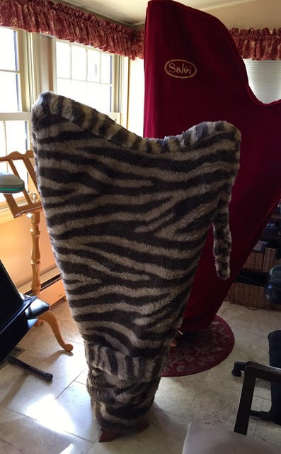 Zebra print harp cover with tail.