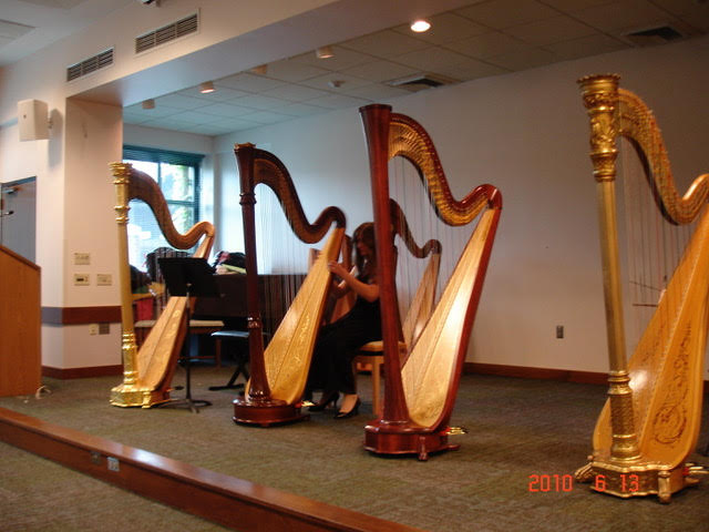 Setting up for annual harp recital.